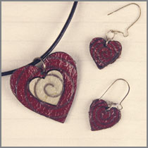 leather bicolour heart with red drops