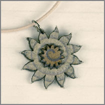 leather sun pendant dark